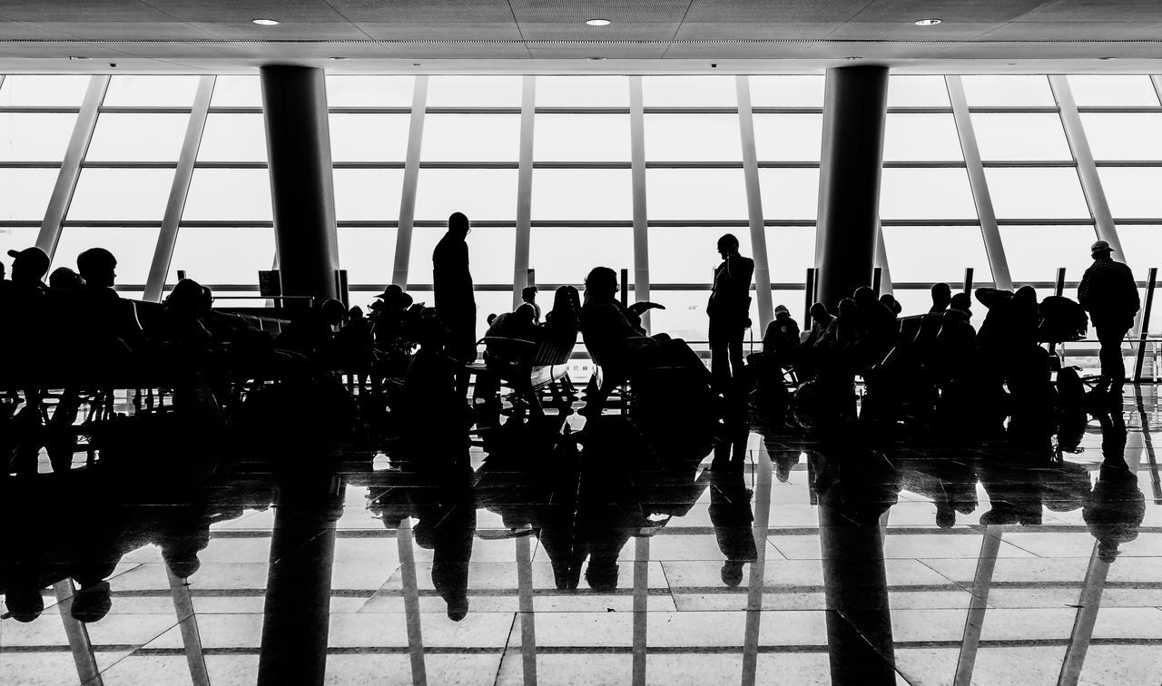 Airport Airport Departure Area Architecture Black & White Black And White Day EyeEmBestPics Indoors  Journey Large Group Of People Luggage Men Passenger Public Transportation Real People Reflection Silhouette Standing The Architect - 2017 EyeEm Awards The Street Photographer - 2017 EyeEm Awards Transportation Transportation Building - Type Of Building Travel Window Krull&Krull Images The Photojournalist