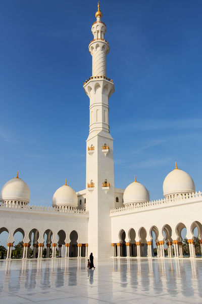 Sheikh Zayed mosque in Abu-Dhabi Abu Dhabi Arabic Arch Arched Architecture Blue Building Exterior Built Structure Clear Sky Courtyard  Dome Faith Famous Place Grand Mosque Islam Mosque People Person Place Of Worship Religion Sheik Zayed Mosque Spirituality Travel Destinations United Arab Emirates White Mosque