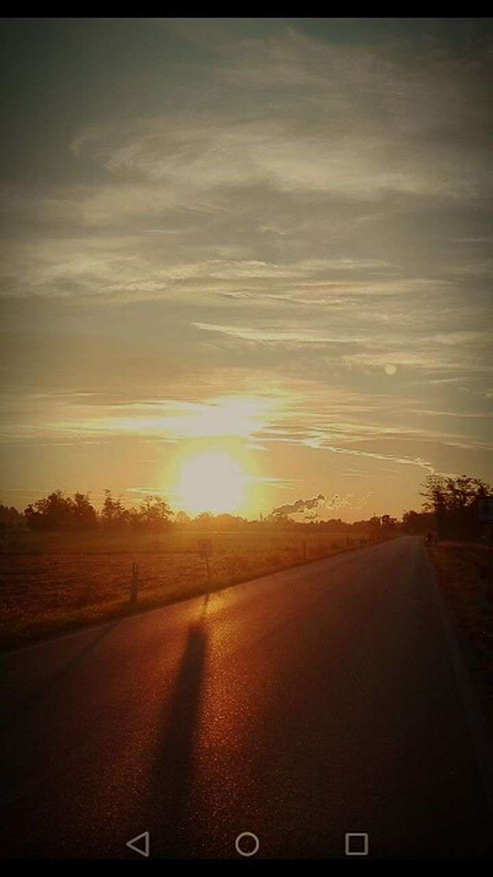 sunset, road, scenics, landscape, sky, the way forward, field, nature, sunlight, sun, no people, car, tranquil scene, transportation, rural scene, outdoors, beauty in nature, cloud - sky, tranquility, tree, day