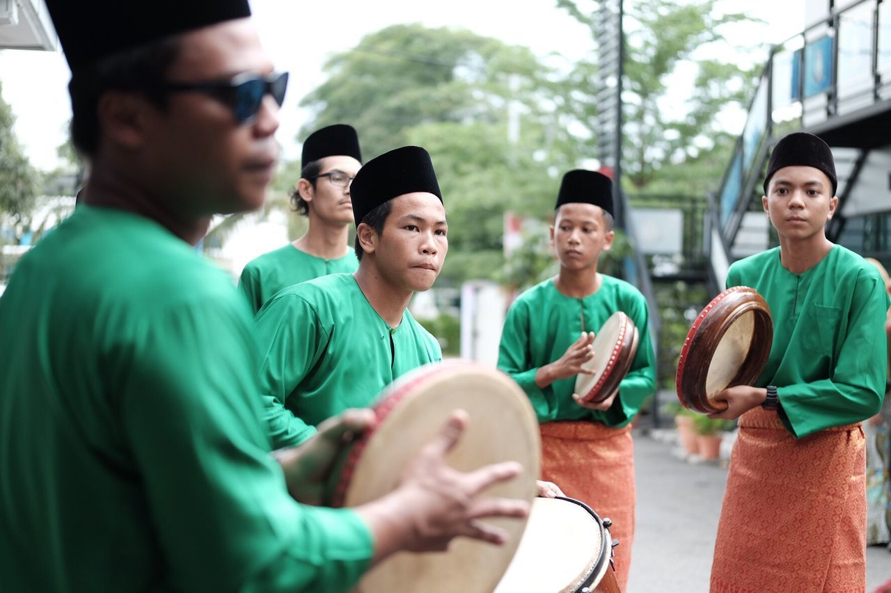 Kompang (percussion-like) group playing music for Malay wedding Medium Group Of People Togetherness Teamwork Men Young Men Self Improvement Volunteer Sport Standing Cheerful Friendship Lifestyles Charity And Relief Work Community Day Young Adult Cooperation Outdoors Baseball Cap Real People Malaysia Truly Asia Traditional