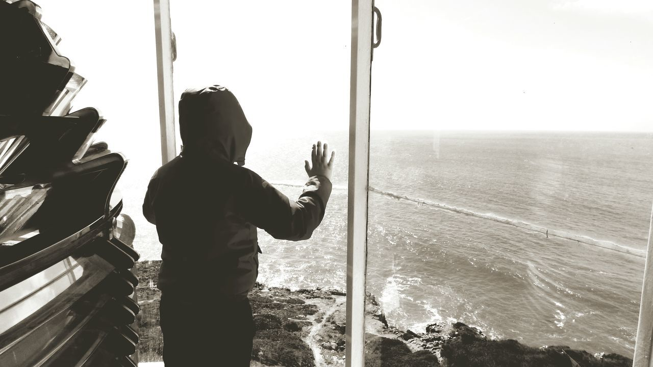 The Boy on the Lighthouse near the Window Looking to the Sea this is My Son Sea View Black And White Black & White Showcase March Looking To The Other Side Little Boy Real People Landscapes With WhiteWall Scenic View Scenic Lookout Eye4photography
