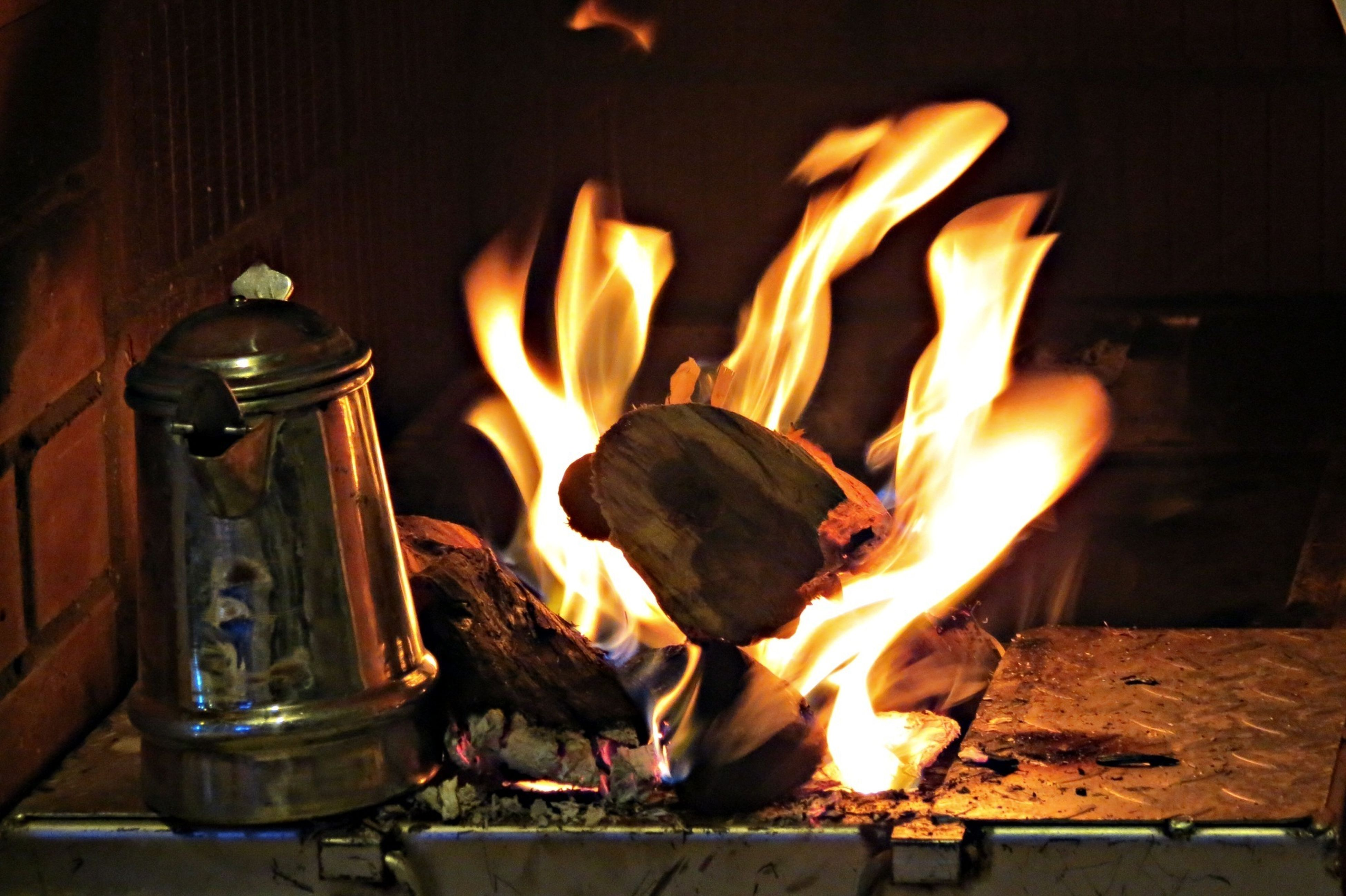 flame, burning, heat - temperature, fire - natural phenomenon, indoors, glowing, fire, firewood, close-up, heat, candle, bonfire, barbecue grill, wood - material, food and drink, preparation, fireplace, cooking, coal, campfire