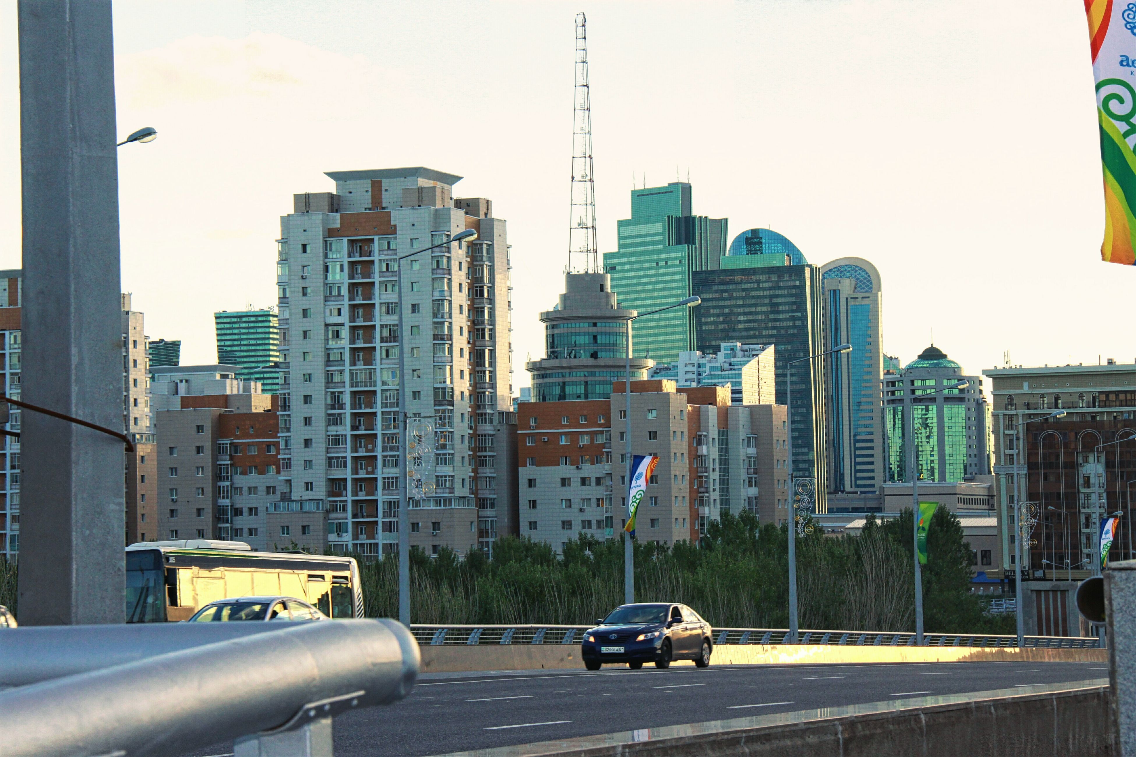 architecture, city, skyscraper, building exterior, built structure, modern, cityscape, transportation, tall, growth, road, no people, day, outdoors, sky