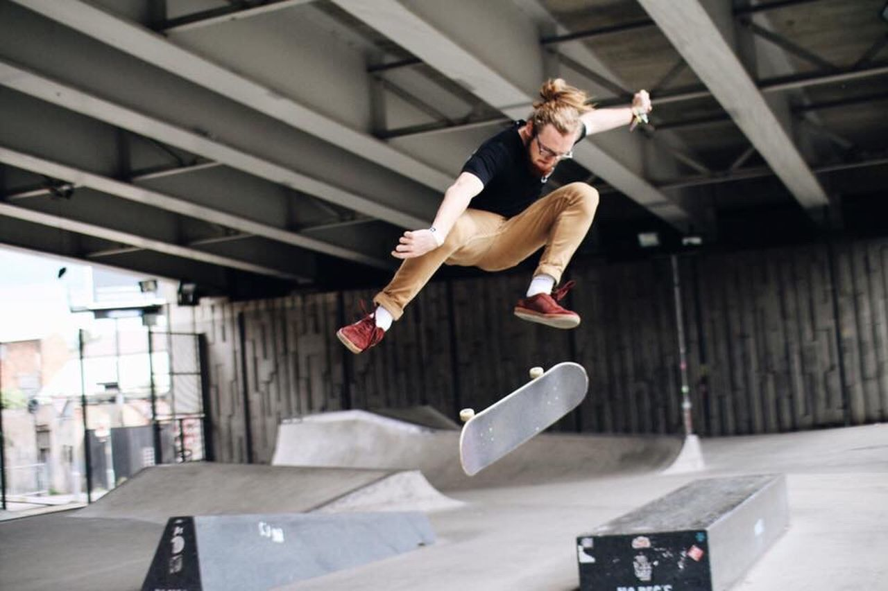 Action shot of a skater in Manchester Casual Clothing Leisure Activity Young Adult Lifestyles Shoe Mid-air Happiness Cool Attitude Park - Man Made Space Enjoyment