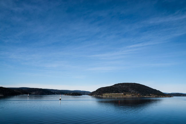 Oscarborg Fortress, Drobak narrows, Norway Beauty In Nature Blue Calm Cloud Cloud - Sky Copy Space Idyllic Island Lake Mountain Mountain Range Nature Non-urban Scene Oscarborg Fortress Rippled River Scenics Sea Sky Tranquil Scene Tranquility Water Waterfront