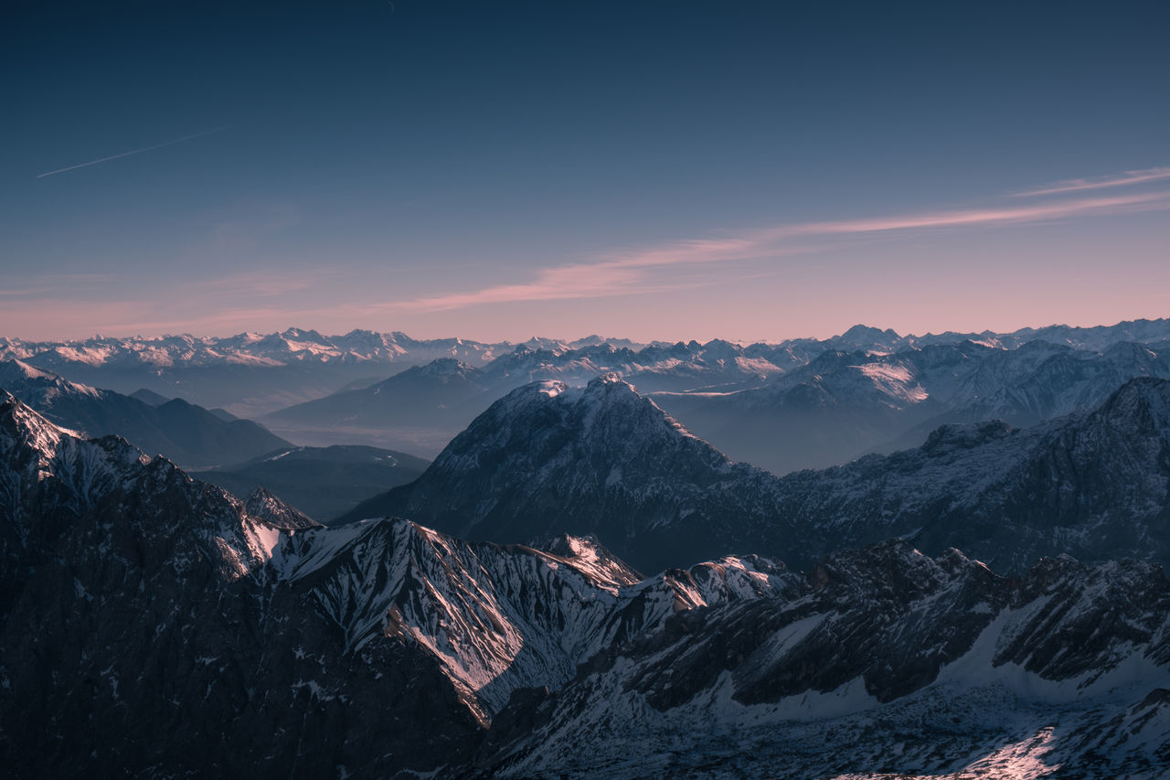 Or is this merely a question of perspective? Location: Bavarian Alps, Germany Equipment: Fujifilm X-T2 + XF18-55 Alpen Alps Bavaria Bavarian Alps Cloud - Sky Deutschland Evening Fuji Germany Landscape Light Magenta Mountain Mountain Peak Mountain Range Mountainscape Night Outdoors Peak Snow Sunset Travel Valley Warm Zugspitze
