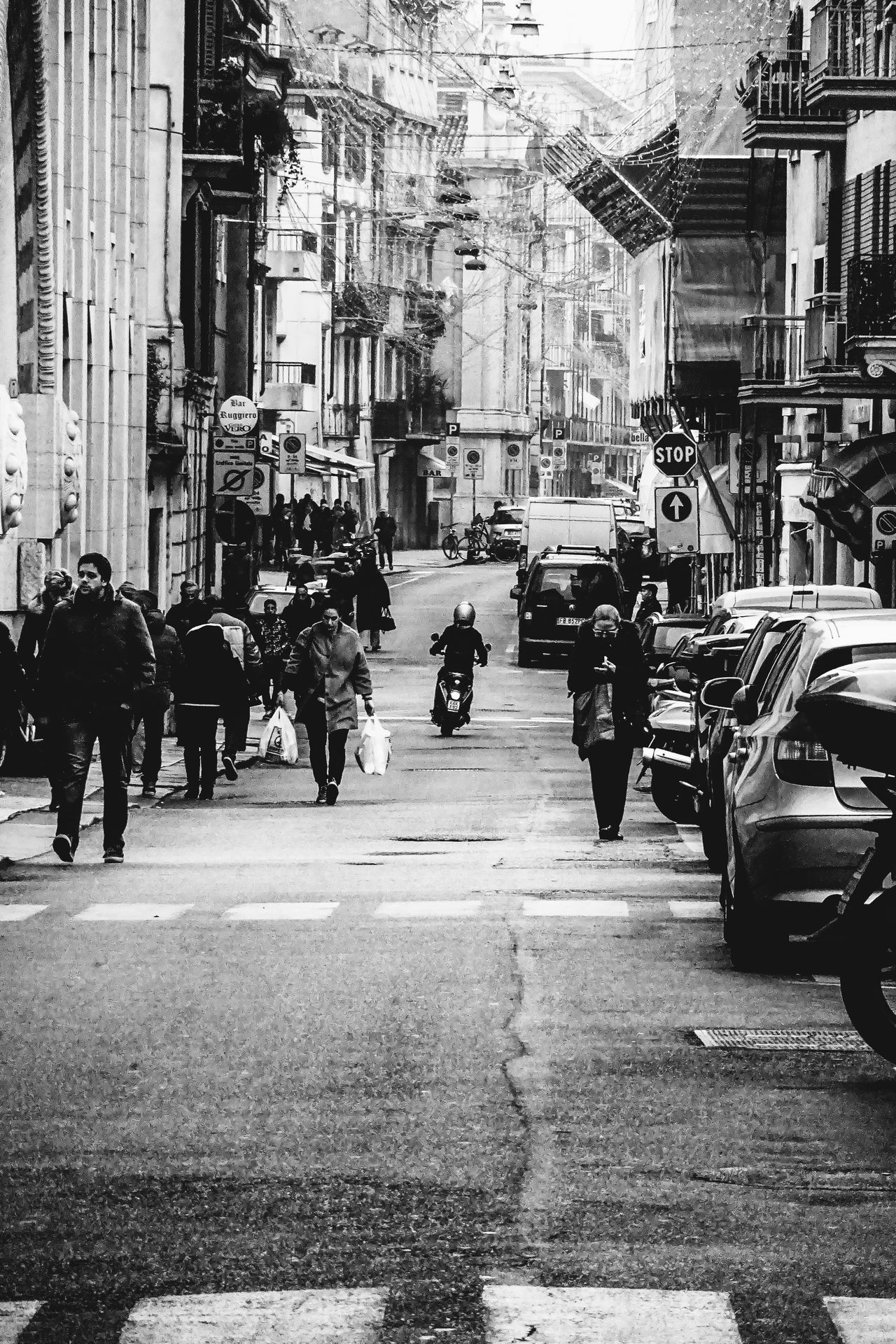 B&w Street Photography Black & White Black And White Blackandwhite Photography Composition EyeEm Gallery EyeEm Masterclass Frame It! Greyscale Leading Monochrome Motorcycles Photography Road Scooter Street Street Photography Streetphotography