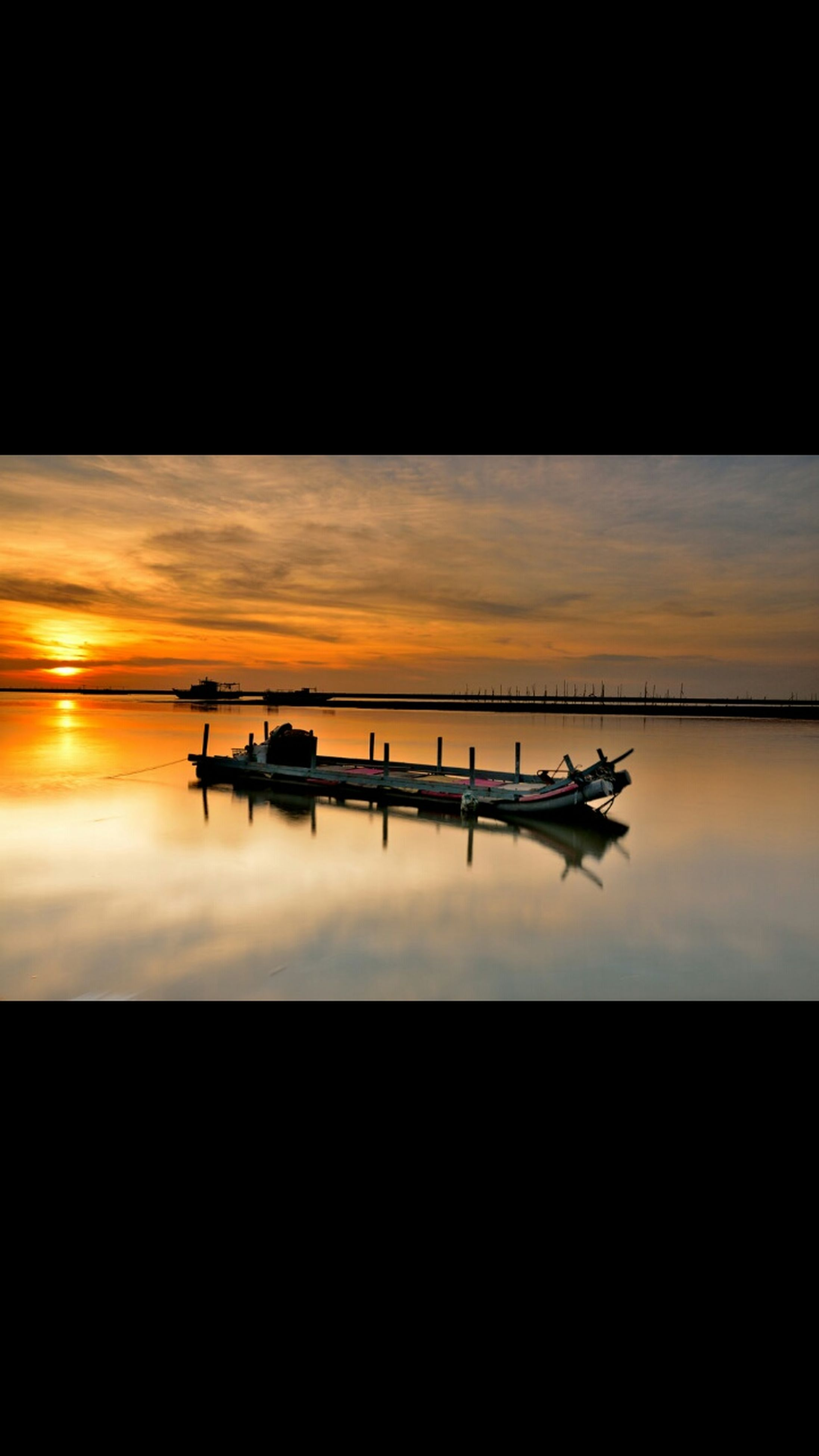 sunset, silhouette, transportation, orange color, water, sky, nautical vessel, mode of transport, sea, beauty in nature, tranquility, tranquil scene, scenics, boat, nature, reflection, copy space, dark, cloud - sky, dusk