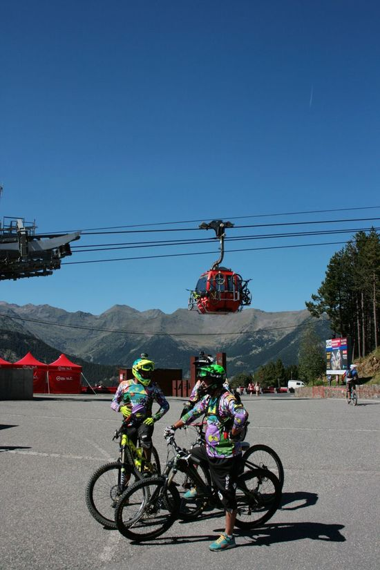 Colorfull mountain cyclists with blue sky and cable car on back ground. Cable Car Friends Adventure Adventure Sport Bicycle Cable Clear Sky Colorful Helmet Land Vehicle Large Group Of People Leasure Activity Lifestyles Men Mode Of Transport Mountain Real People Road Sky Togetherness Transportation Been There. Done That.