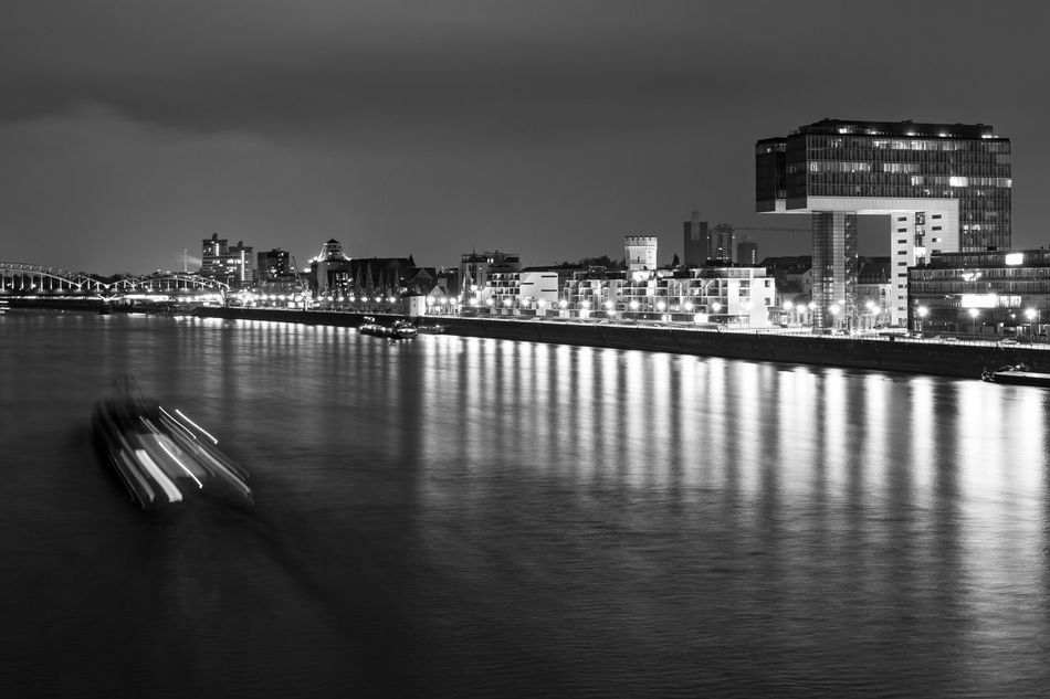 """Cologne by night: """"Kranhaus"""" Architecture Blackandwhite Building Exterior Built Structure Cityscape EyeEm Best Shots Illuminated Night No People Reflection Water Waterfront Welcome To Black"""