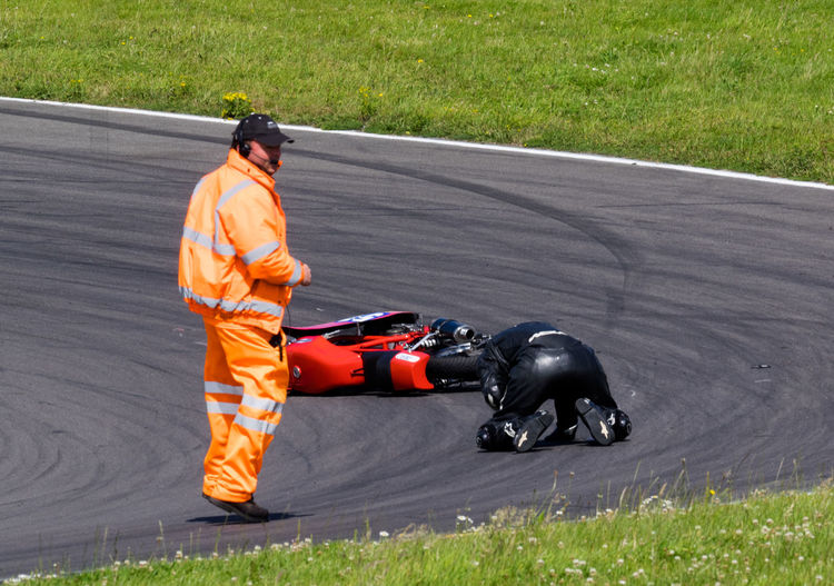 British Historic Motorcycle Racing, Trac Mon, Anglesey. Injured Motorcycle Motorcycle Photography Accident Accidents And Disasters Injured Rider Injury Motorcycle Racing Motorcycle Racing Accident Race Marshall Racetrack