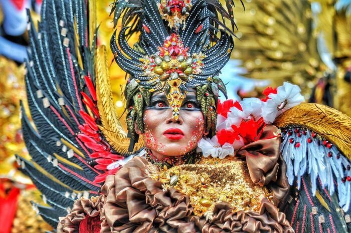 Jember 2016. Dancer attracts on jember fashion carnival. Arts Culture And Entertainment Feather  Headdress Celebration Dancer Gold Colored Multi Colored Headwear Day Adults Only Adult Outdoors People One Person Close-up Only Men Connected By Travel Connected By Travel