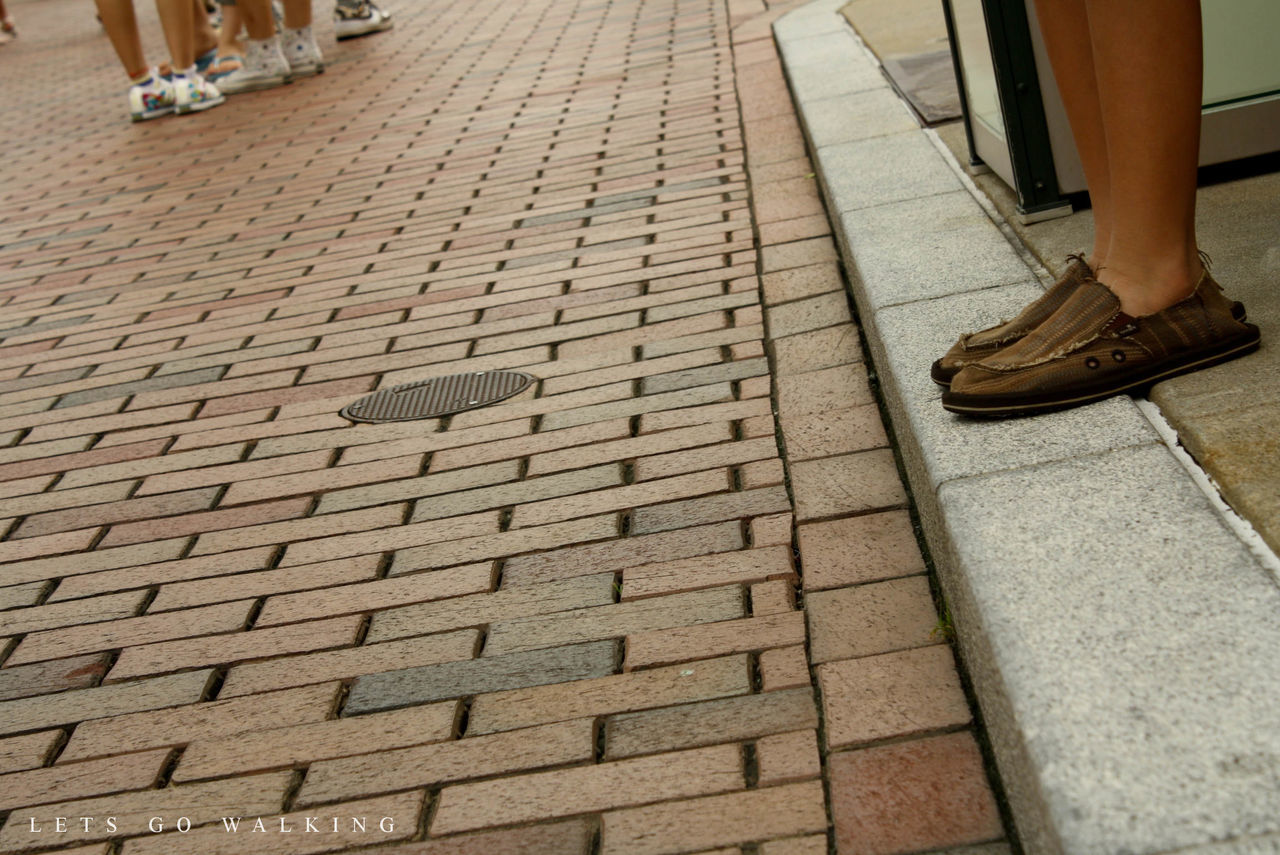 cobblestone, low section, shoe, human body part, outdoors, human leg, day, one person, close-up, one man only, adult, people
