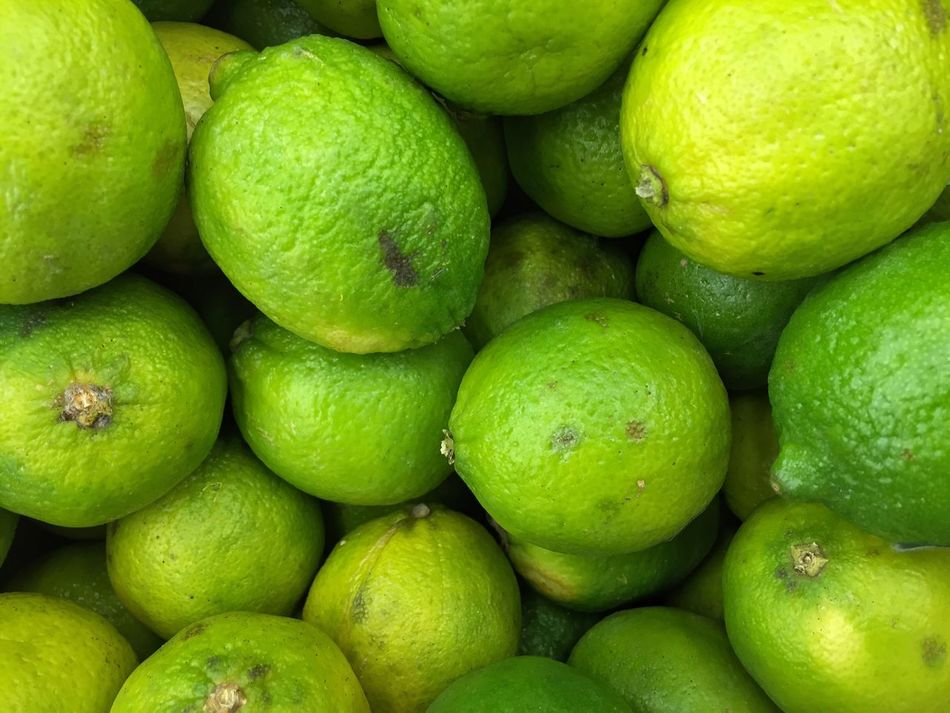 Fruit Freshness Food Healthy Eating Full Frame Green Color Lime Retail  Food And Drink Juicy Citrus Fruit Backgrounds No People Stack Large Group Of Objects Business Market Market Stall For Sale Heap