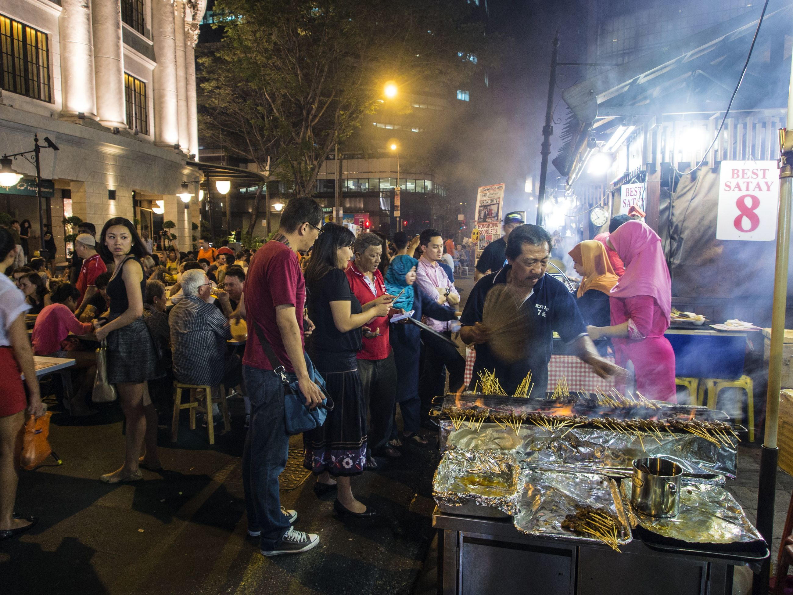 men, person, large group of people, lifestyles, market, market stall, crowd, retail, night, leisure activity, celebration, illuminated, for sale, street, standing, event, selling, shopping, casual clothing