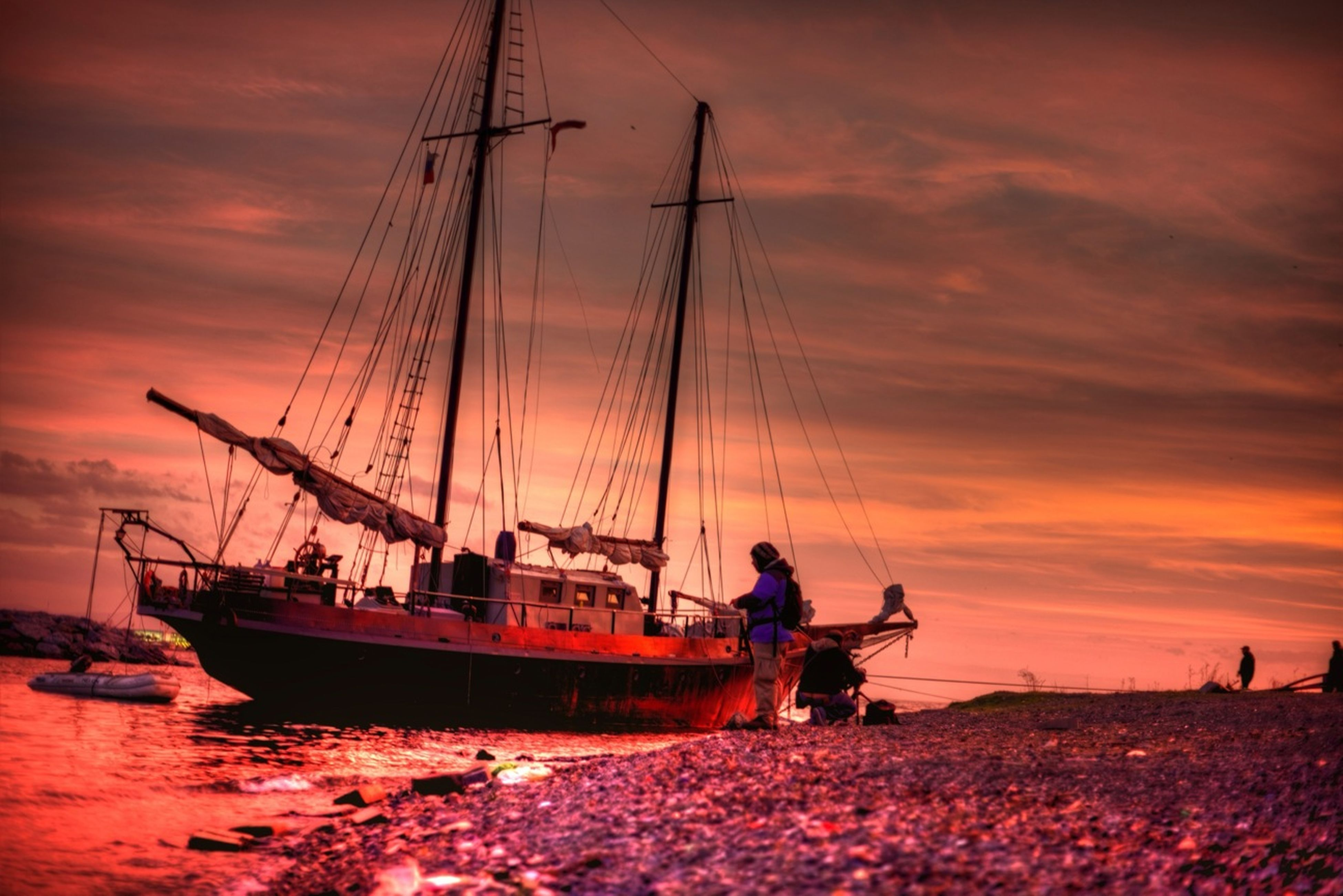 nautical vessel, transportation, boat, mode of transport, water, sunset, sky, sea, men, leisure activity, silhouette, mast, cloud - sky, lifestyles, scenics, orange color, moored, travel