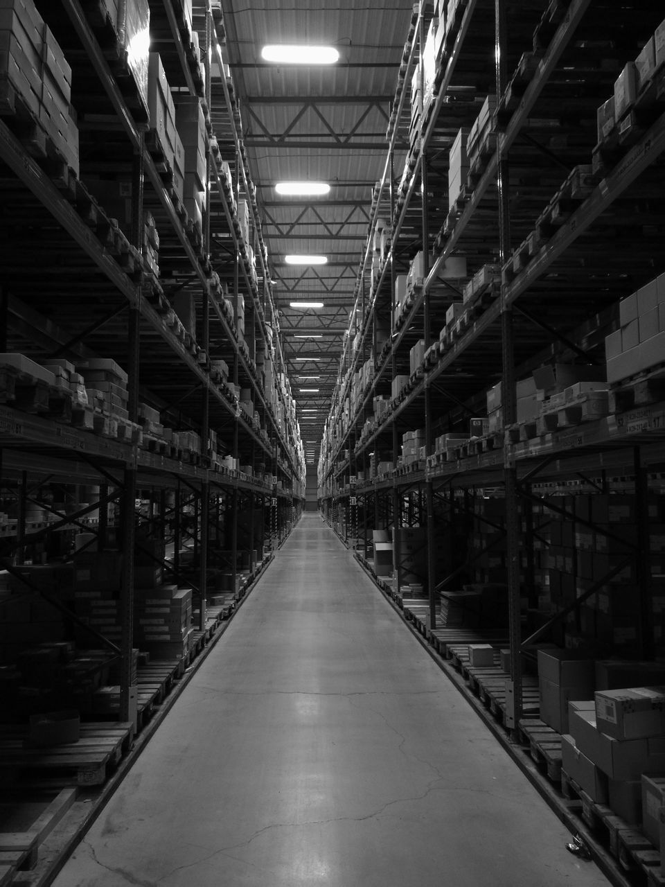 shelf, indoors, warehouse, diminishing perspective, in a row, the way forward, storage compartment, distribution warehouse, storage room, factory, corridor, industry, illuminated, freight transportation, no people, shipping, architecture, day