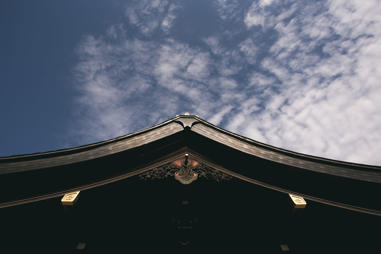 low angle view, architecture, built structure, sky, no people, cloud - sky, architectural column, outdoors, day, building exterior