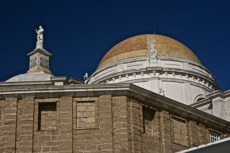 Church Dome and Statue Architecture Building Exterior Built Structure Historic Place Of Worship Religious Architecture Sky Solidity Spirituality Stone Symmetry