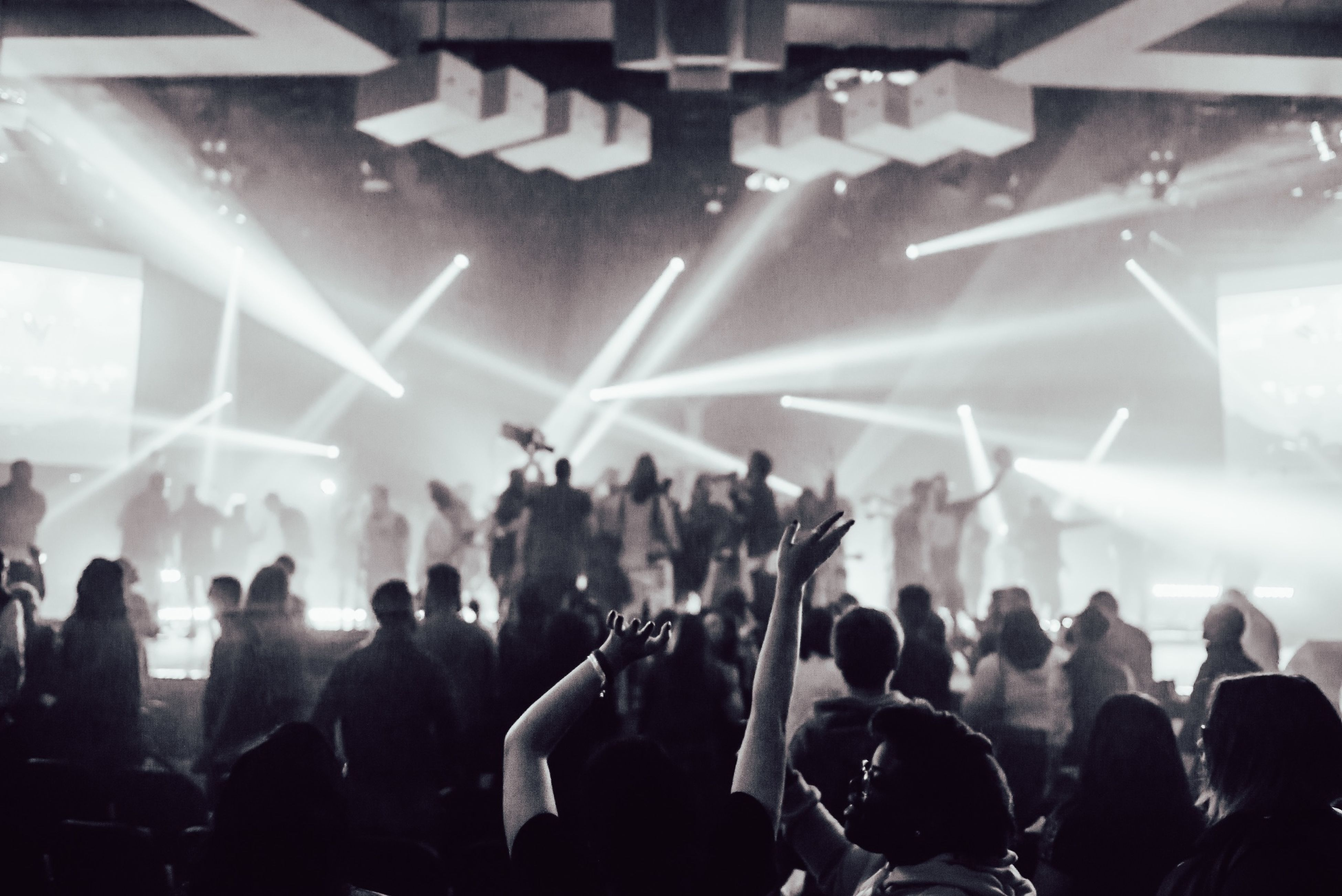 indoors, large group of people, crowd, lifestyles, men, illuminated, person, performance, arts culture and entertainment, nightlife, music, leisure activity, stage - performance space, enjoyment, lighting equipment, event, togetherness, popular music concert