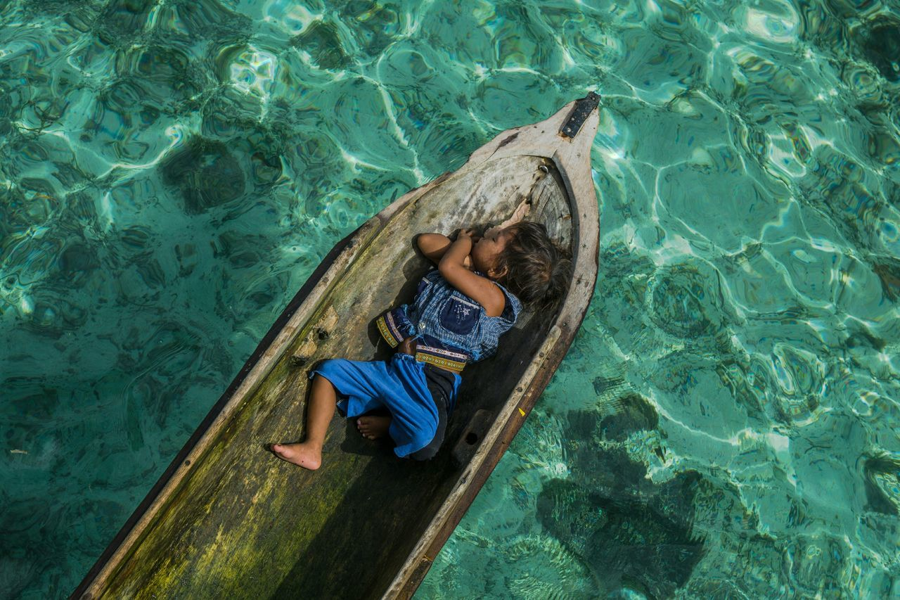 Slepping Kid Bajaulaut Sea Gypsies Semporna Malaysia Wooden Boat Kid Slepping One Boy Sabah Maiga Feel The Journey Color Of Life Hidden Gems  Home Is Where The Art Is Colour Of Life Color Palette EyeEm x Canon - Feel the journey Eyeemphoto A Bird's Eye View Two Is Better Than One