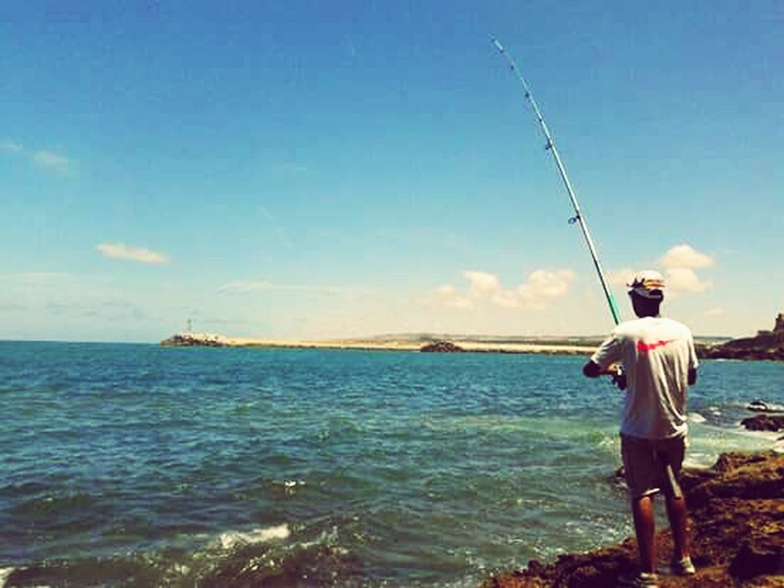 water, sea, leisure activity, lifestyles, full length, sky, horizon over water, nautical vessel, fishing, men, standing, rear view, fishing rod, beach, nature, casual clothing, vacations, beauty in nature
