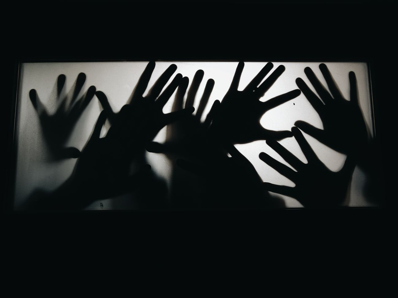 """""""We're Here..."""" Human Hand Shadow Human Body Part Back Lit Silhouette Touching Horror Frosted Glass Adult Indoors  Storytelling Experimental Conceptual EyeEm Gallery Moto X Play Photo Smartphone Photography My Smartphone Life"""