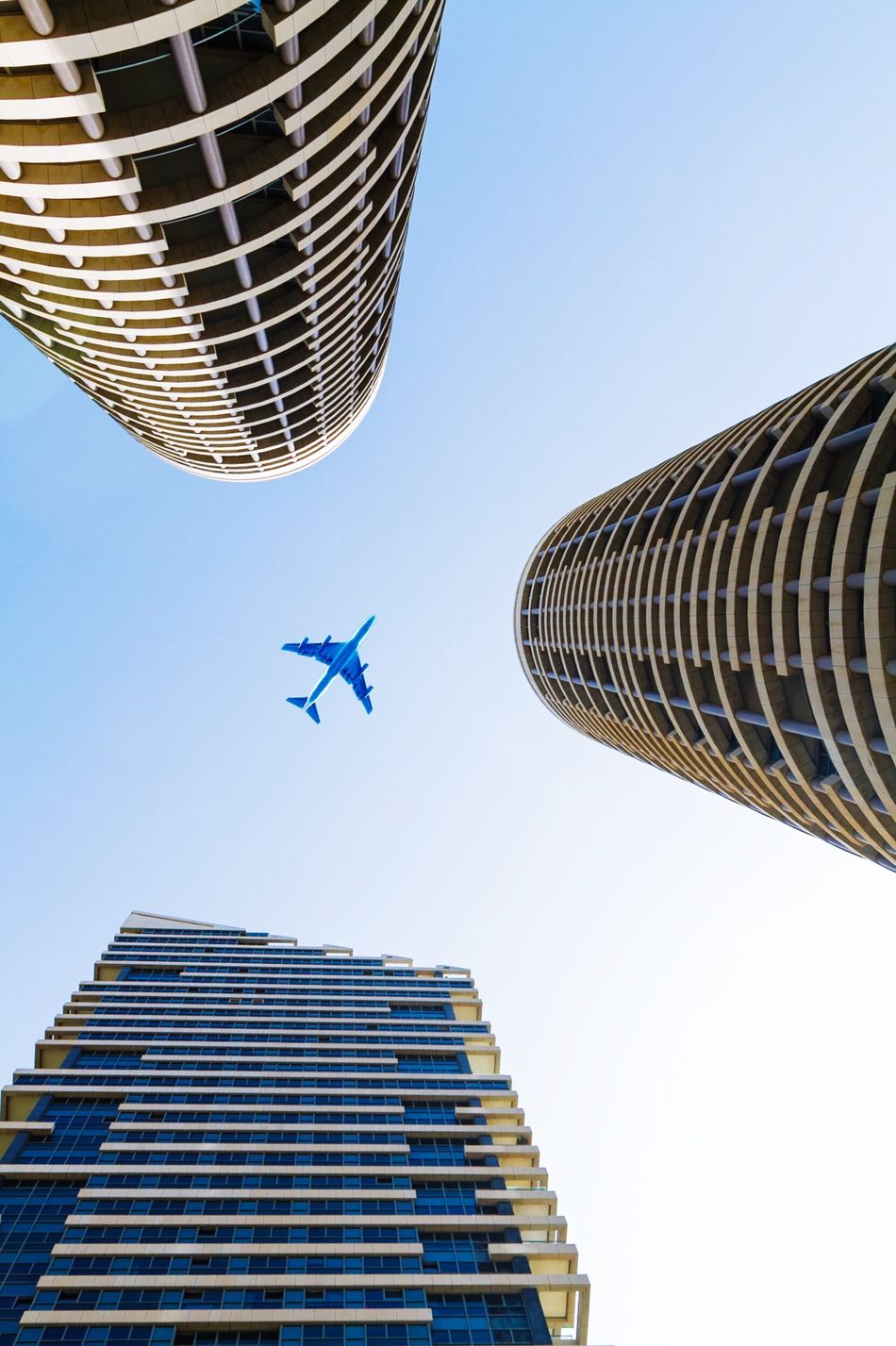 Up about Low Angle View Architecture Built Structure Airplane Skyscraper Building Exterior Flying Day Clear Sky AirPlane ✈ Blue Outdoors No People Modern City Sky EyeEmNewHere