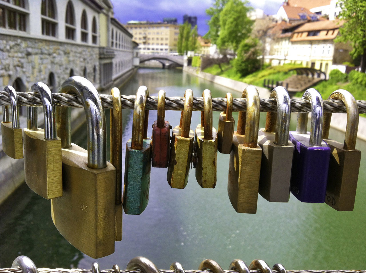 Bridge Cityscapes Close-up Different Sizes Focus On Foreground Hanging Hopes And Dreams Ljubljana Lock Locks Locks Of Love Love Love Lock Love Sign Metal My Year My View No People Padlock Perspective Photography Promise Protection Riverside Safety Streetphotography Water