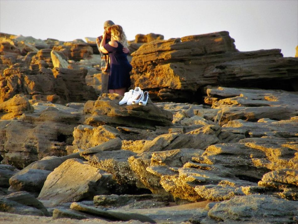 Outdoors People Sand Dune Beach Shoes Rock Formations Couples In Love Embracing Love Couple Photography Couple Kissing  Embrace Sand Day Rock Formation Shoes ♥