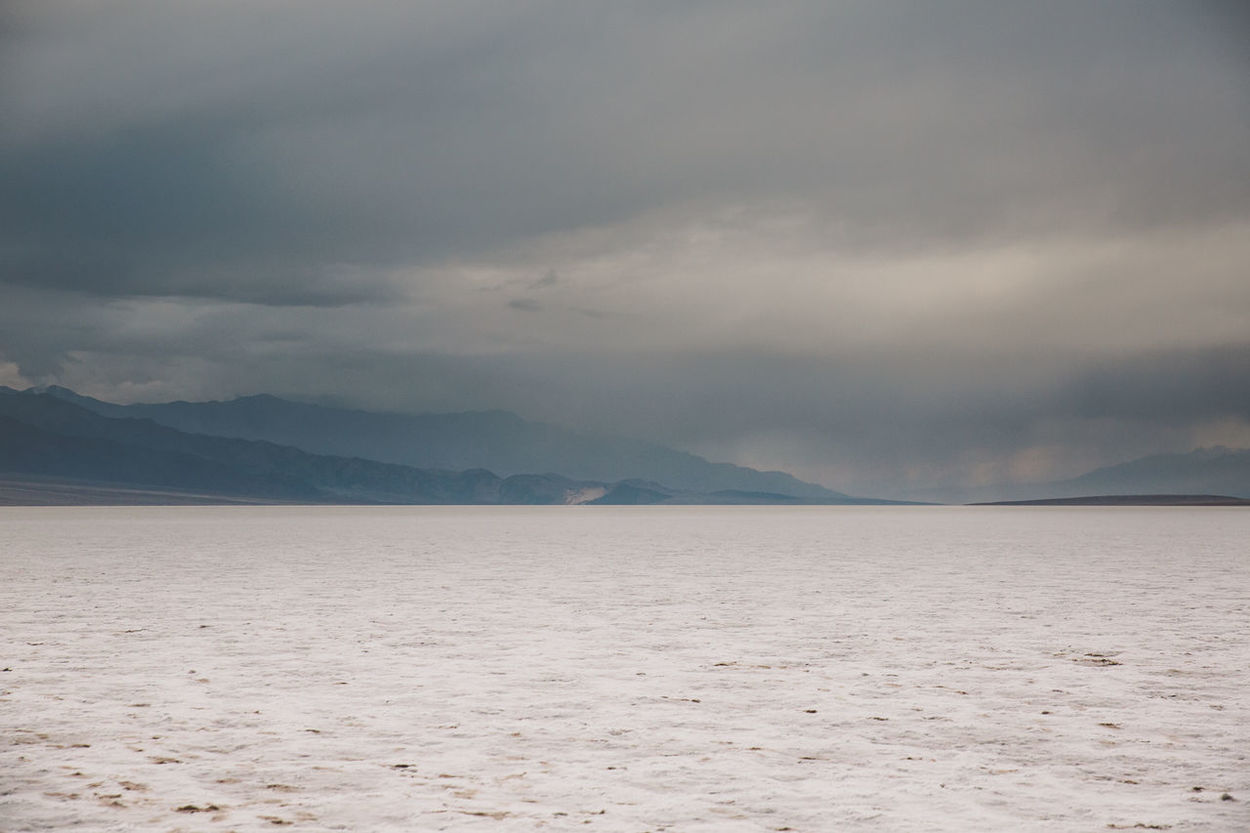 Arid Climate Arid Landscape Badwater Basin Beauty In Nature Cloud - Sky Clouds Day Death Valley Death Valley National Park Death Valley, California Desert Landscape Mountain Mountain Range Nature No People Outdoors Salt Scenics Sea Sky Storm Tranquil Scene Tranquility Water