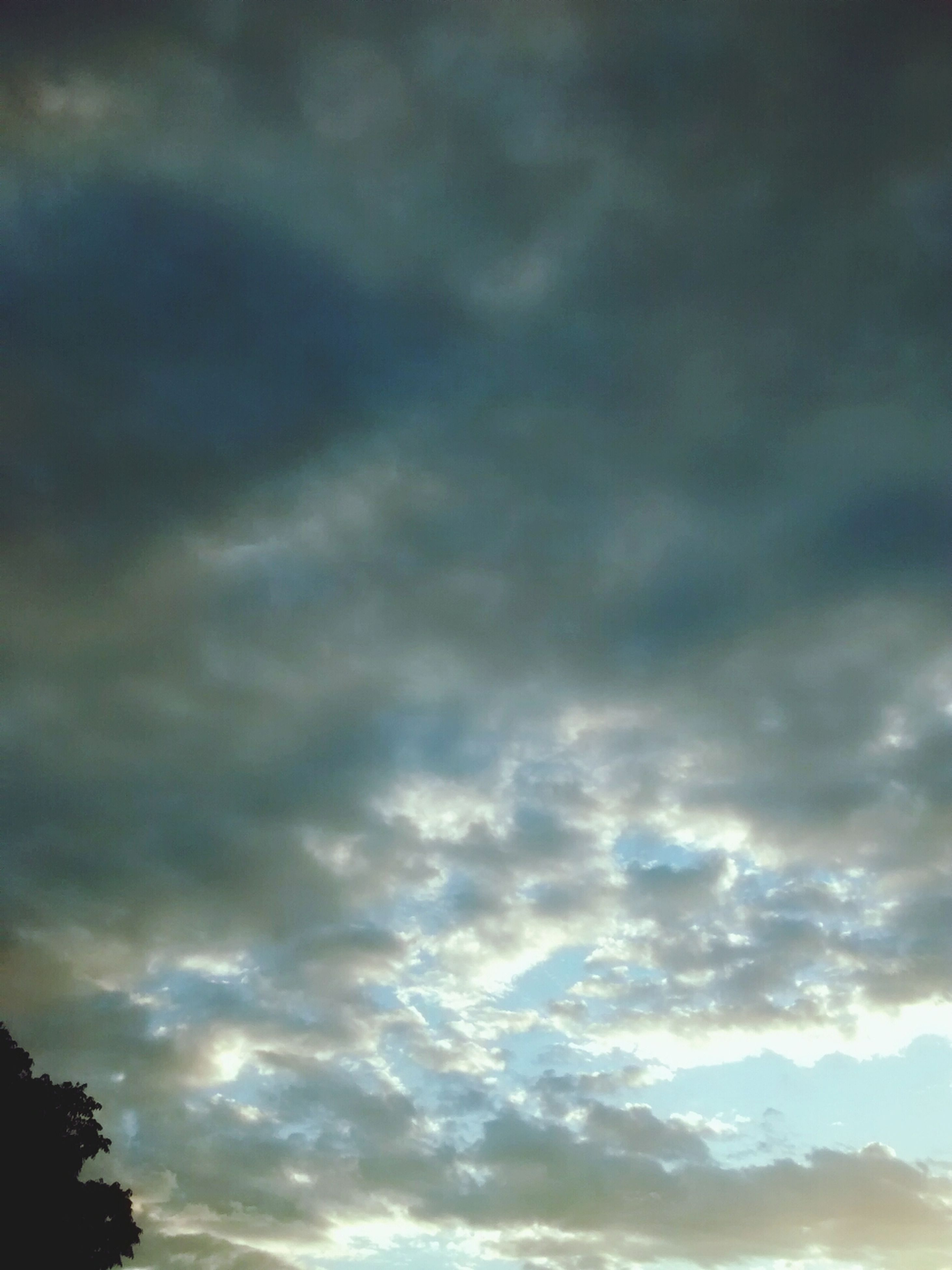 sky, cloud - sky, cloudy, low angle view, beauty in nature, tranquility, scenics, weather, overcast, tranquil scene, cloudscape, nature, cloud, dramatic sky, sunset, silhouette, storm cloud, idyllic, dusk, outdoors