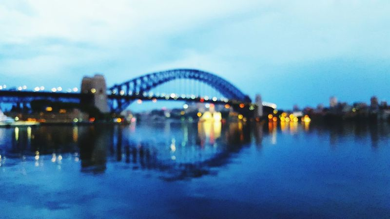 Blurred vision! The Great Outdoors - 2016 EyeEm Awards Bridge - Man Made Structure Reflection Water Architecture Outdoors Travel Destinations No People Cityscape Arch Blessed  Beautiful View Caption This Harbour Bridge View Tourism International Landmark Majestic Cloud - Sky Sunrise And Clouds Brilliant Colors
