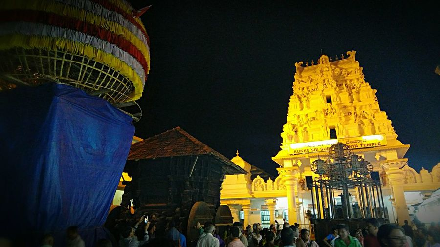 Photo of Kuttu Subrahmanya swamy temple. Really heart touching experience at temple premises. Very powerful God too. 800 years old temple. Religion Place Of Worship Travel Destinations Gold Colored Tradition Architecture Travel Tourism Night Built Structure Spirituality Building Exterior Large Group Of People Business Finance And Industry Illuminated Sky Pilgrimage City Arts Culture And Entertainment People First Eyeem Photo