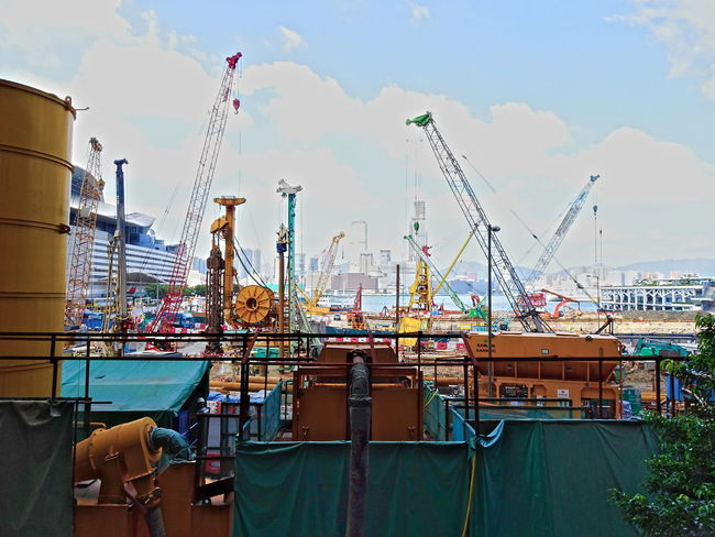 Construction Side Business City City Life Cloud - Sky Colors Commercial Dock Construction Construction Site Crane Day Harbor HongKong Horizontal No People Sea Sky Skyscraper Streetphotography Working