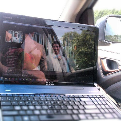 On the last leg of the trip and getting a headstart on color correcting Kym & Mike's wedding pictures. Editonthego