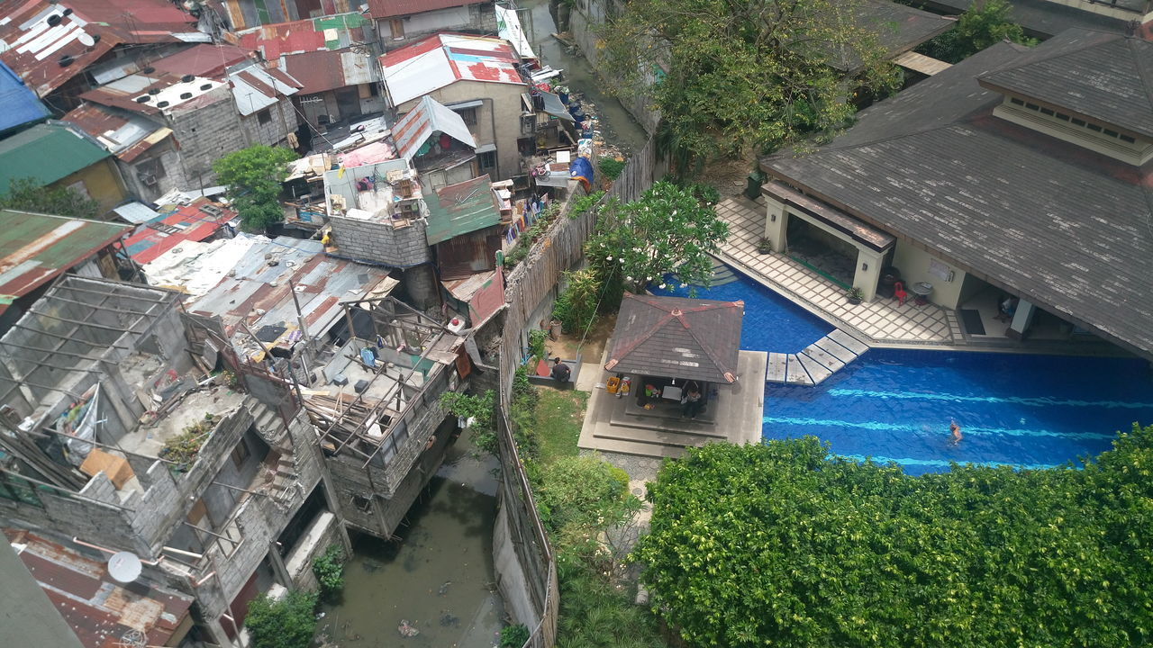High Angle View No People Opposites Outdoors Poverty Cityscape EyEmNewHere Diversity No Edit/no Filter Citylifes Citylife Rich VS Poor EyeEmDiversity Swimming Pool Break The Mold Philippines Vacations Phone Photography Welfare