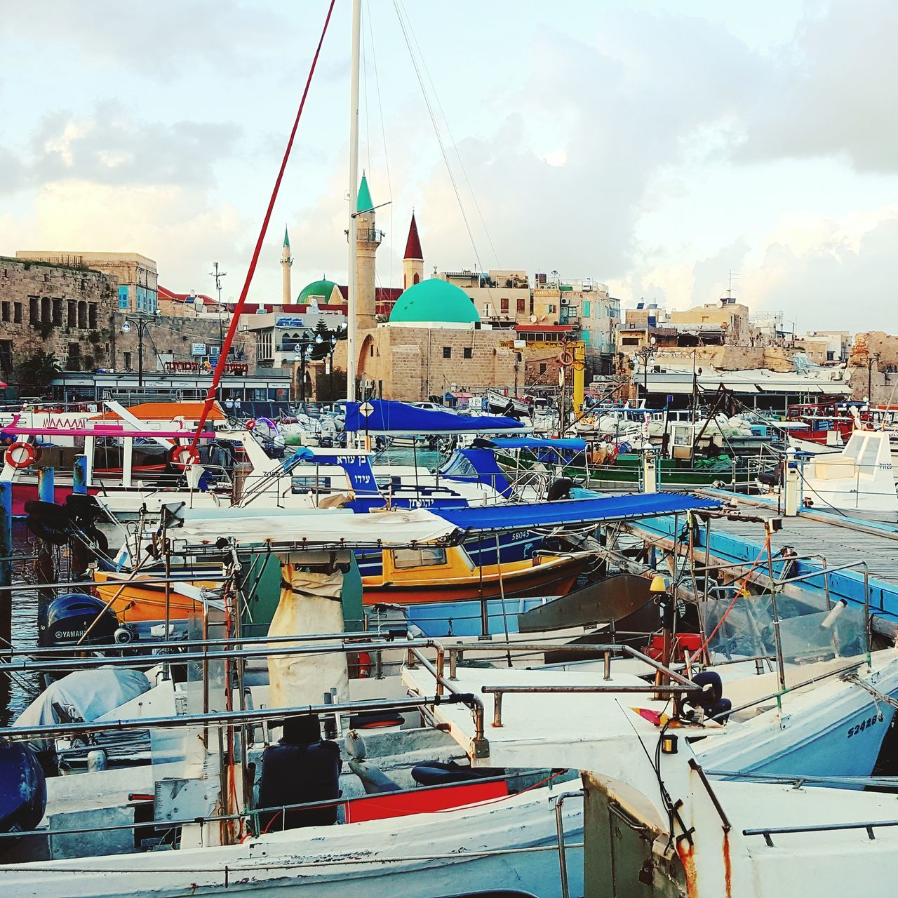 port in the Arabian city Cloud - Sky Outdoors Marina Sea Water Transportation Ship Moored No People Sunset Vacations Beach Commercial Dock Travel Destinations Nautical Vessel Yacht