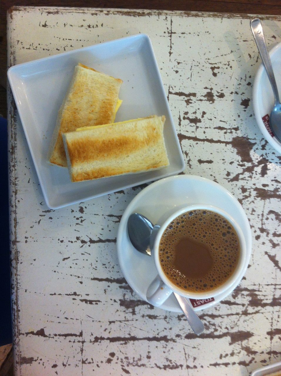 food and drink, coffee cup, coffee - drink, table, drink, freshness, refreshment, breakfast, food, indoors, bread, slice, no people, close-up, healthy eating, leftovers, ready-to-eat, day