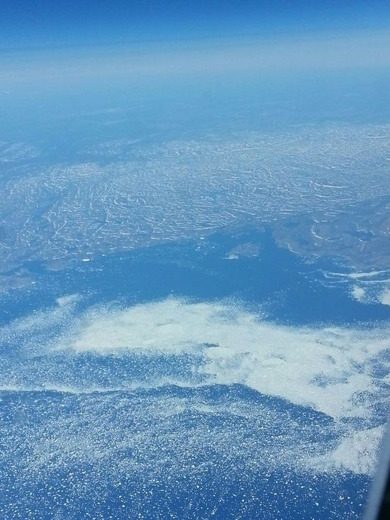 View of North Atlantic Ocean Sea Ice from Airplane Window . Ocean Climate Water Airplane Window View Canada Environment Sea Blue Blue Wave Climate Change Ice Bergs View From Above Spring June Summer Earth Blue Earth