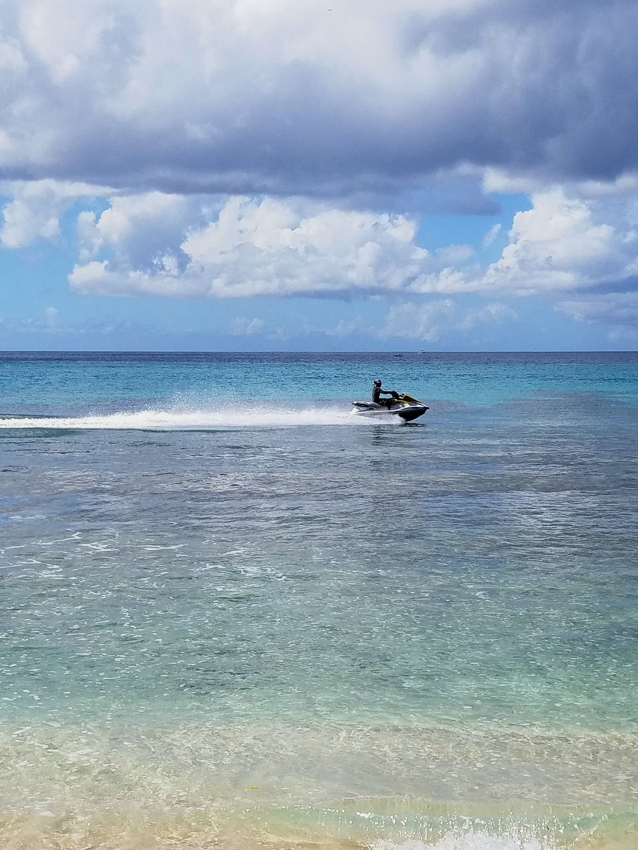Sea Nautical Vessel Horizon Over Water Transportation Cloud - Sky Sky Outdoors Water Day Open Edit St Kitts Postcard Tropical Climate Seascape Travel Destinations Jet Ski Travel Blue Beach Water Sport Summer Vacations Sea And Sky Crystal Clear Waters Barbados