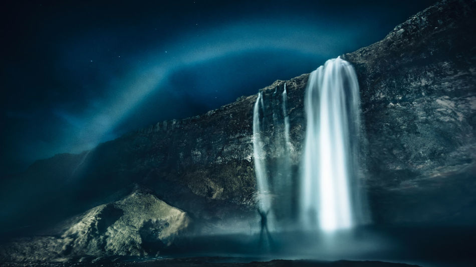 In Iceland, you get to see rainbows even at night Astronomy Beauty In Nature Blue Epic Iceland Landscape Long Exposure Low Angle View Mountain Nature Nature Night Night Photography No People Power In Nature Rainbow Rock - Object Rocks Scenics Seljalandsfoss Travel Destinations Water Waterfall Waterfalls Break The Mold
