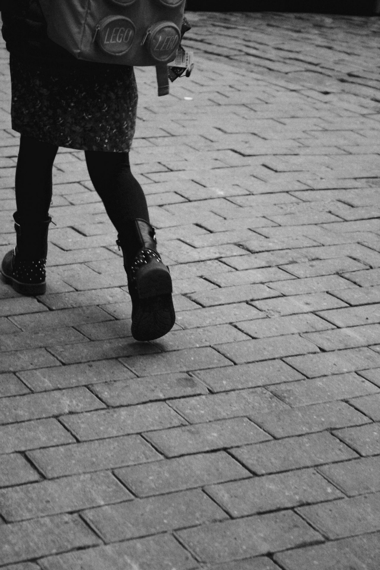 Backpack Bag Casual Clothing City Life City Street Day EyeEm Gallery Going To School Lifestyles Low Section Monochrome Photography Old Town Outdoors Paving Stone Person Shadow Shoes Stone Material Walking