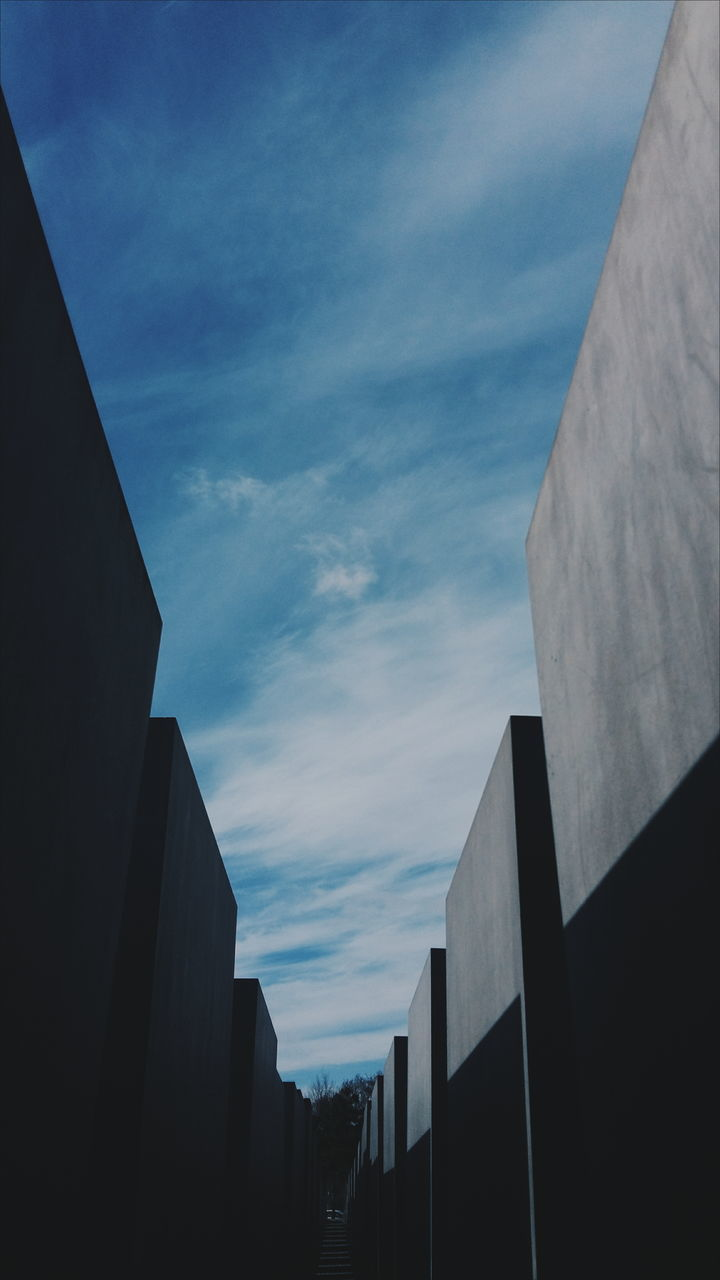built structure, architecture, building exterior, sky, low angle view, no people, outdoors, cloud - sky, day, city