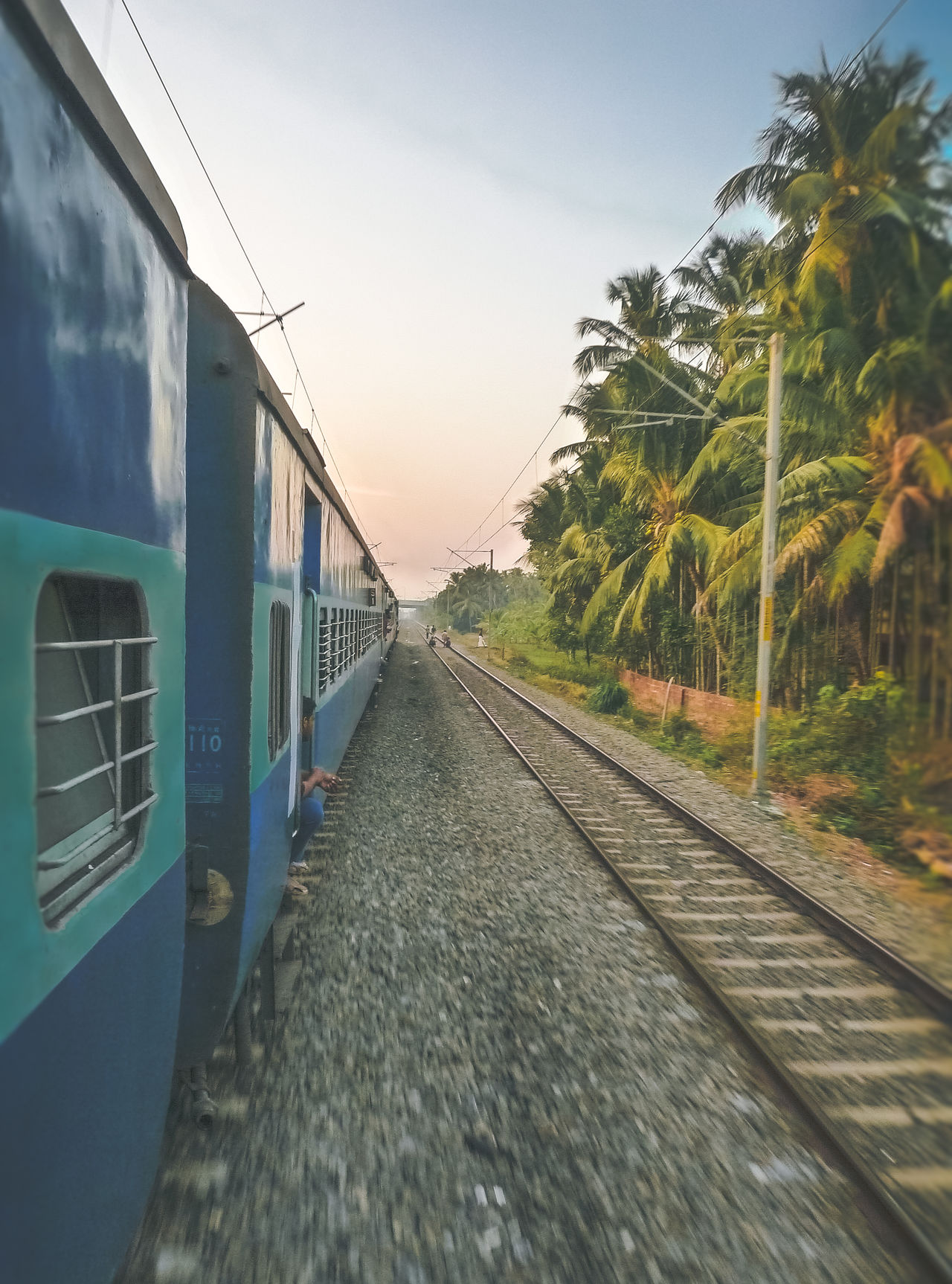 Hippie India Indian Journey Kerala Moving One Person Outdoors Palmtrees Rail Transportation Railroad Track Railway Railway Track Sky Soft Light Sunset The Way Forward Train - Vehicle Transportation Travel Traveling Travelling