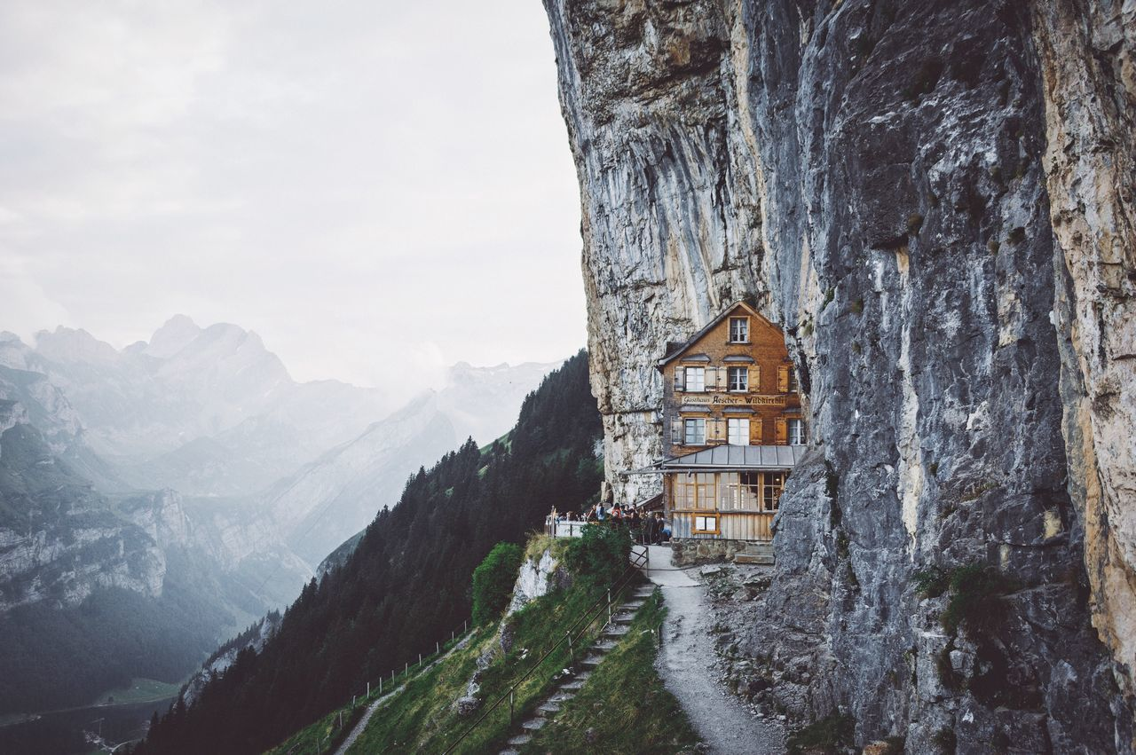 Carved into the mountains. Switzerland Summer Mountain Architecture Beauty In Nature Scenics Nature Built Structure Building Exterior Snow Mountain Range Winter No People Tranquility Sky Tree Landscape Outdoors Day