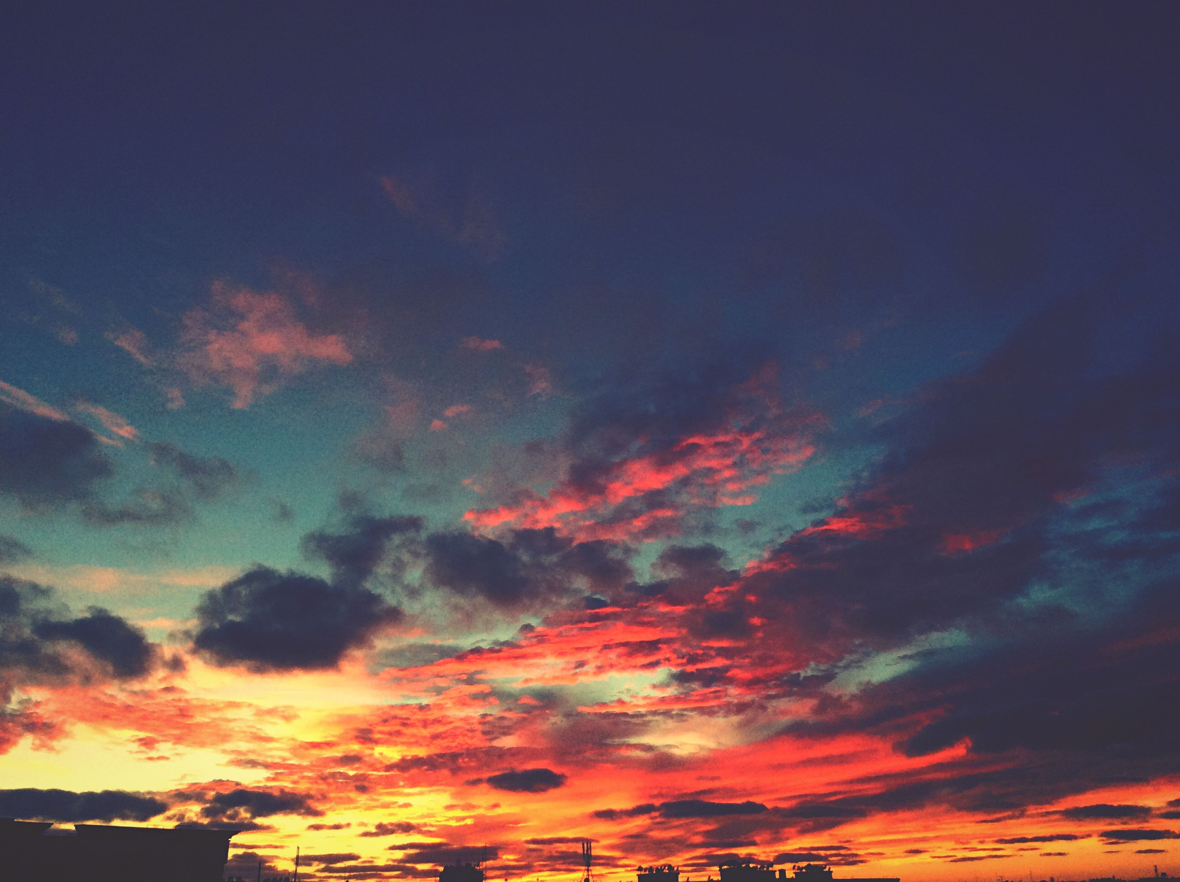 sky, sunset, beauty in nature, orange color, low angle view, cloud - sky, scenics, tranquility, dramatic sky, tranquil scene, nature, cloudy, idyllic, backgrounds, cloud, cloudscape, sky only, outdoors, majestic, weather