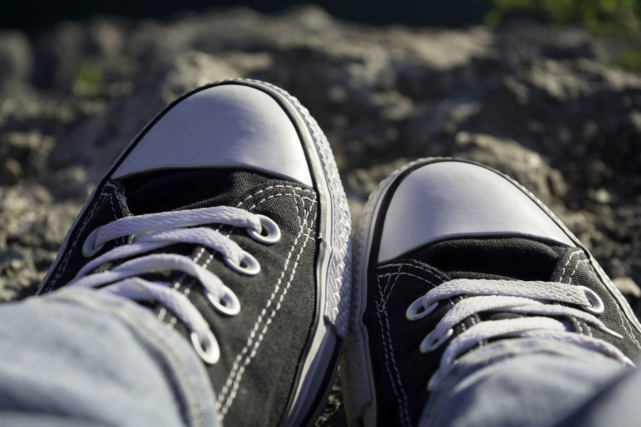 Sitting at the edge of the quarry. Black Color Canvas Shoe Close-up Day Depth Of Field Fashion Human Body Part Human Leg Lifestyles Low Section One Person Out Of The Box Outdoors Pair People Personal Perspective Real People Shoe Shoelace Things That Go Together Women