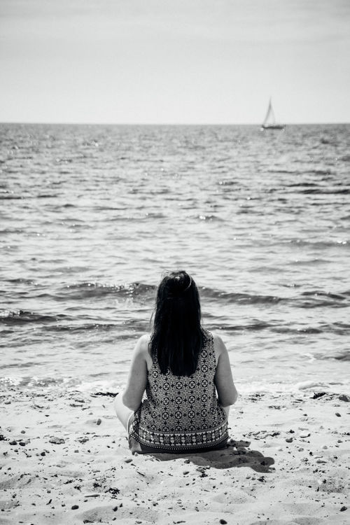 Beach Blackandwhite Carefree Getting Away From It All Horizon Over Water Leisure Activity Long Hair Rear View Remote Sea Shore Sitting Solitude Tranquil Scene Tranquility Vacations Water