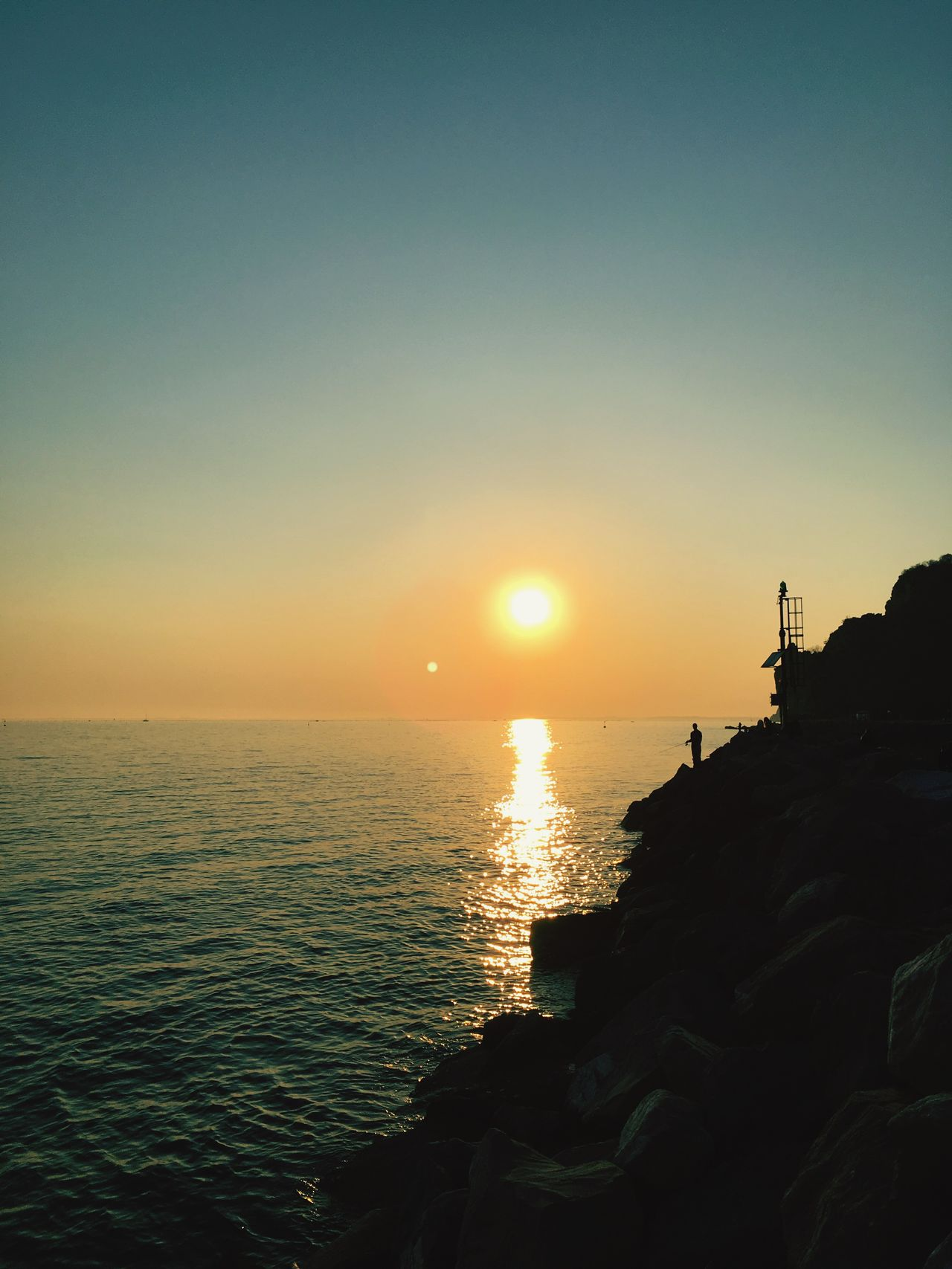 Sea Sunset Water Sun Horizon Over Water Beauty In Nature Scenics Nature Sky Tranquility Idyllic Outdoors Tranquil Scene Clear Sky No People Day Fishing